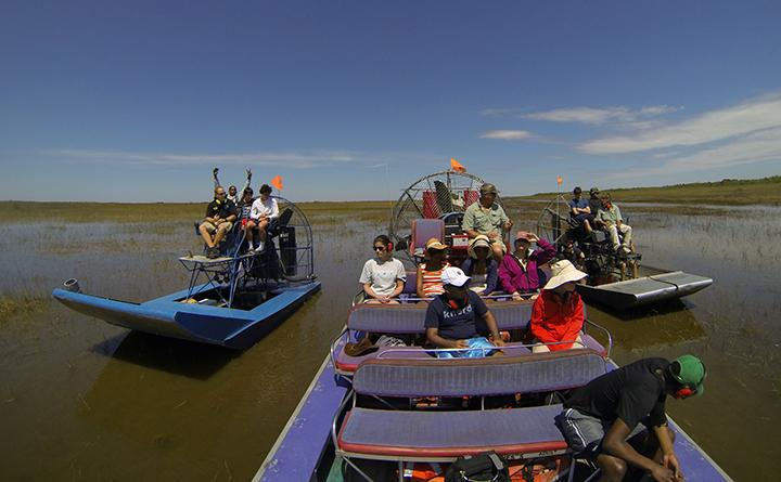 Students travel by air boat in the Everglades